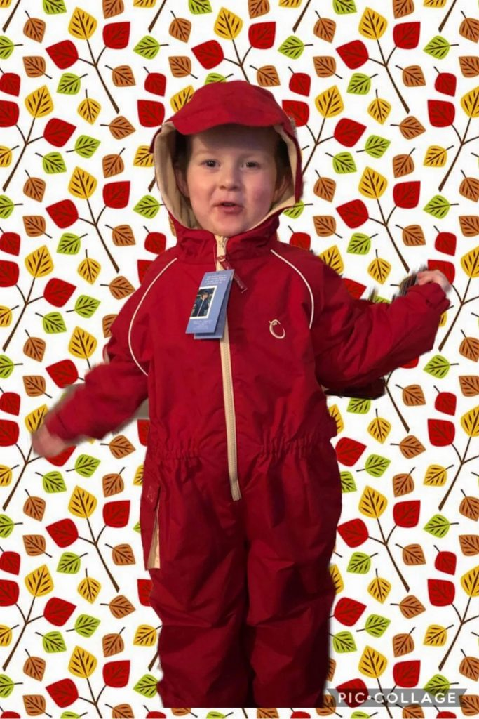 boy in red rain suit
